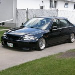 Black Honda Civic EK Sedan on 15X8 BBS RM with Gold Hardware