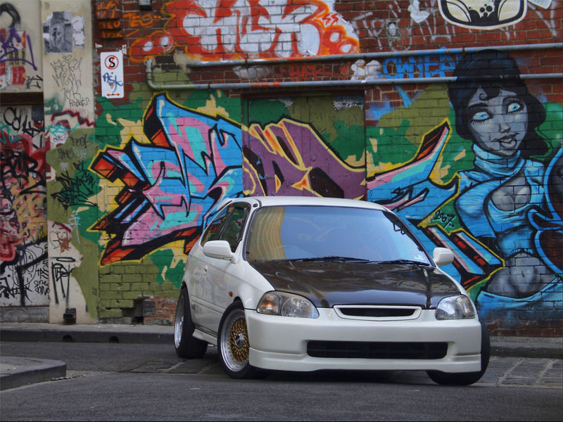Championship White Honda Civic EK Hatchback on Gold BBS RS