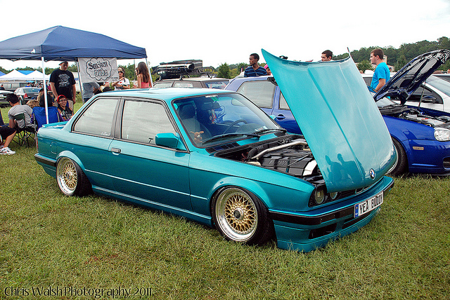 Green BMW E30 on Gold BBS RS