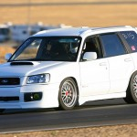 White Subaru Forester on BBS LM with Red Capson the Track