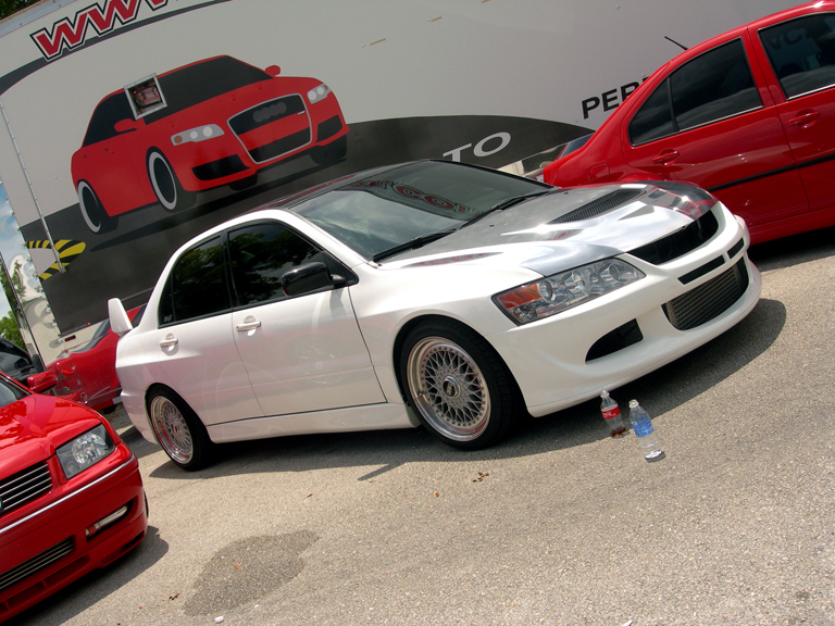 White Mitsubishi Lancer Evolution on BBS RS