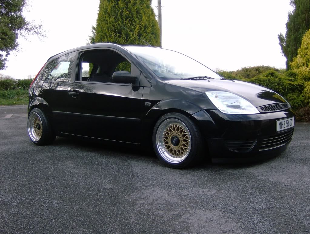 Black Ford Fiesta on Gold BBS RM