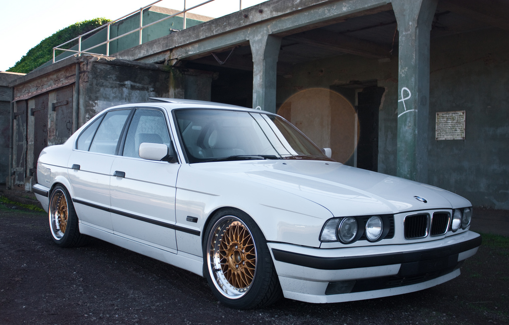 White BMW e34 Sedan on Gold Face BBS RC