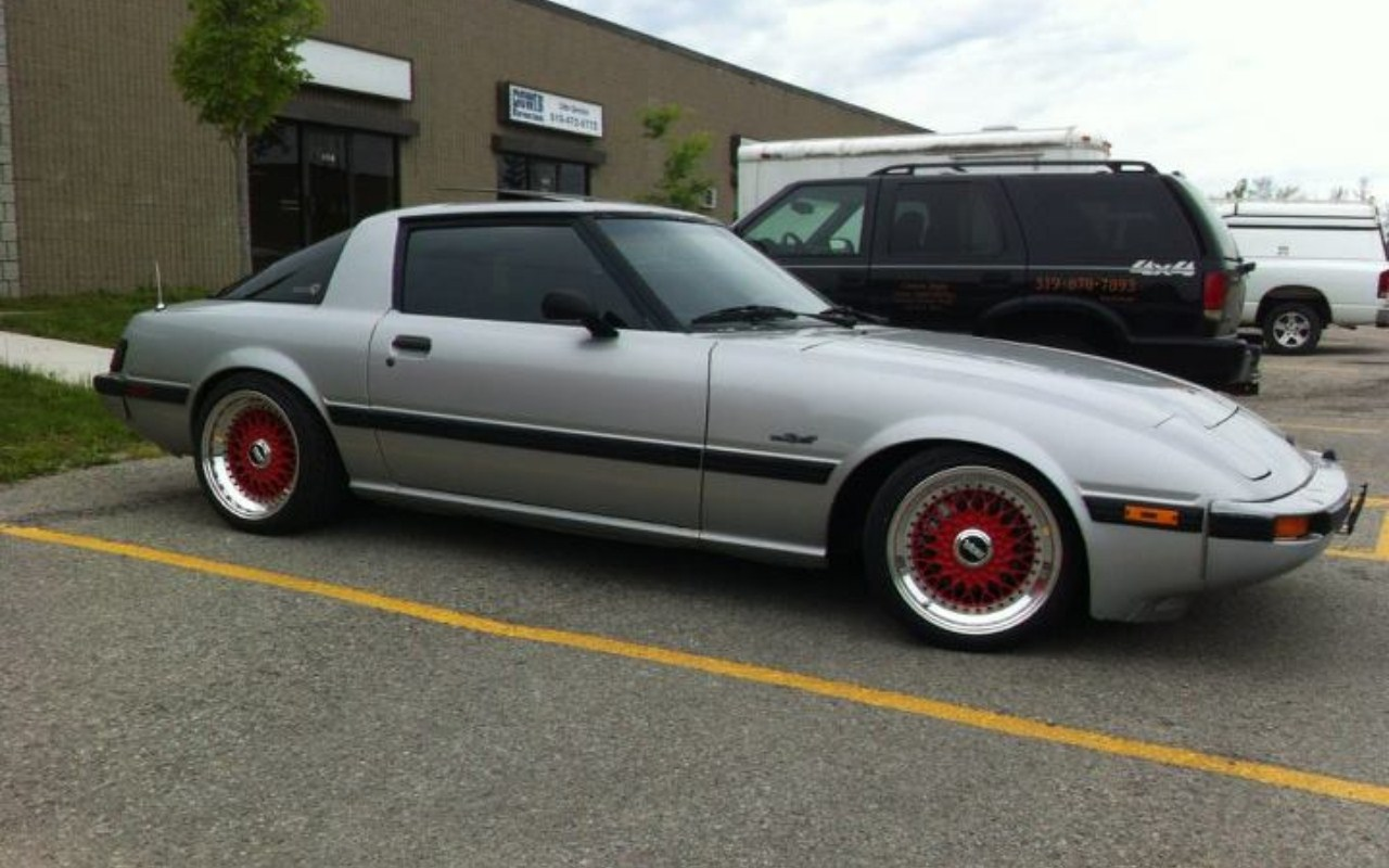 "Silver Mazda RX7 FB on 16"" Red BBS RS"