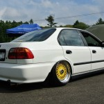 "White EK Honda Civic Sedan on 16"" Yellow BBS RS"